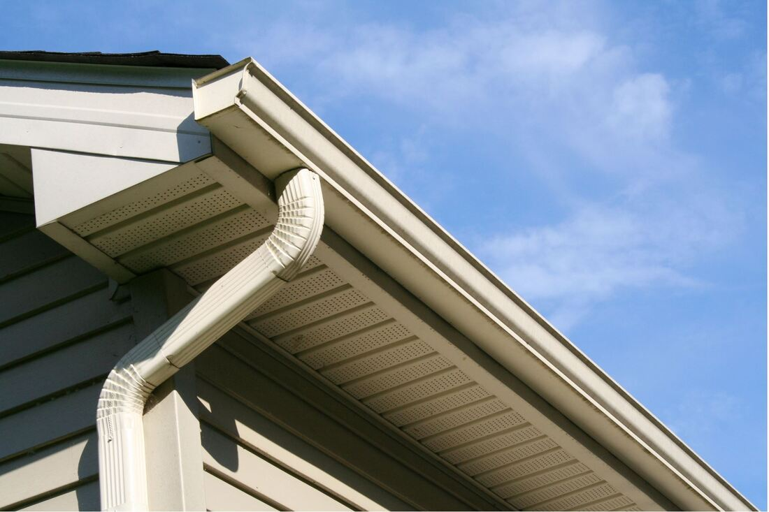 Low angle photo of a house with guttering and downspout